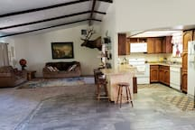 The kitchen and living room are located right outside of the private guest room.  You are welcome to use this space, but it is shared with the owners.  Please fee free to cook in the kitchen.  You are welcome to any pots/pans/dishes you need.