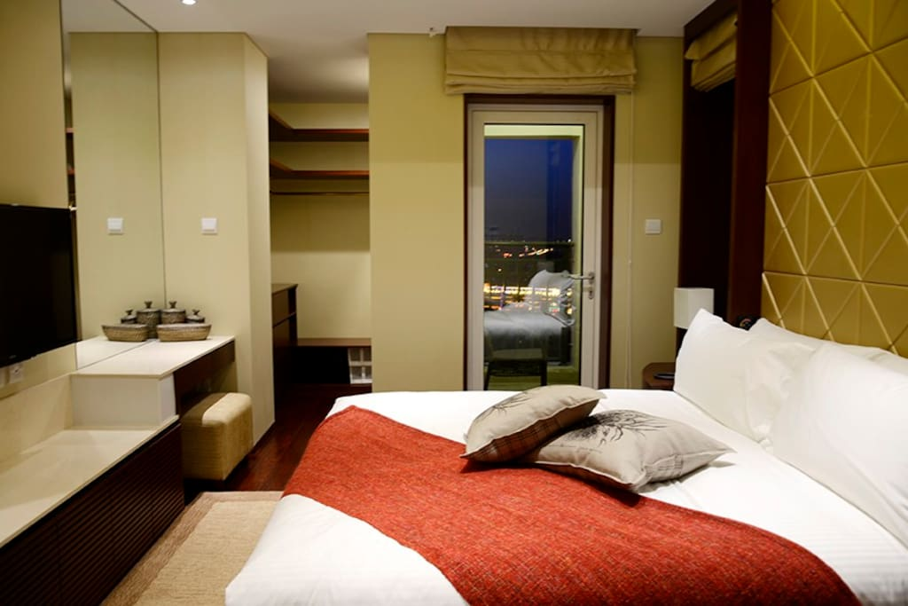 Comfortable King size bed with walk-in wardrobe, toilet with bath and stand up shower cubicle