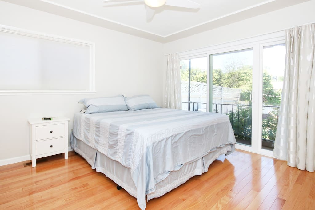 Cal King Temper-Pedic bed with sliding glass door to backyard patio