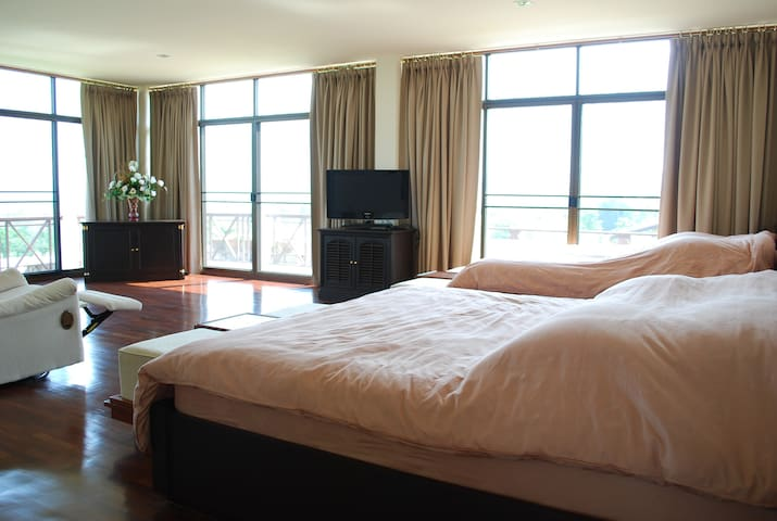Master bedroom, with a great view of greenery