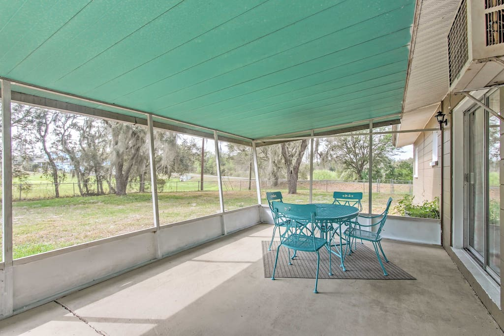 Enjoy a warm cup of coffee outside on the screened-in patio.
