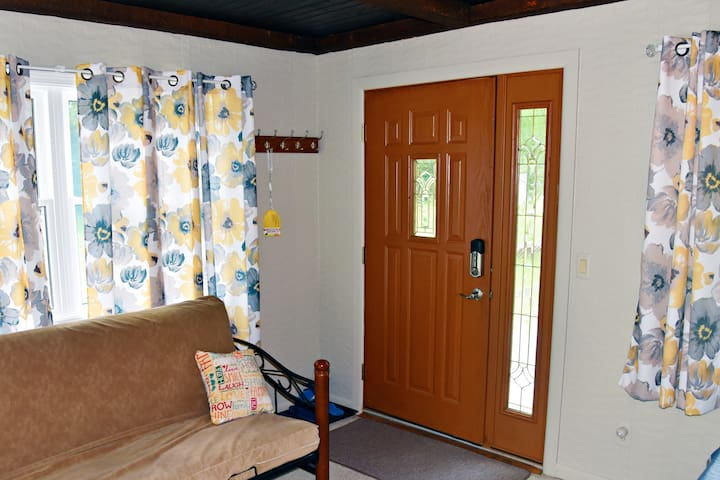 Entry room with queen futon, shown, and daybed with trundle bed off to the right.