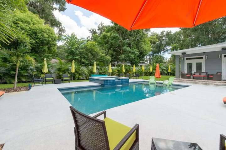 Resort style saltwater pool and jacuzzi. Newly completed! Privacy fence and beautiful palms create an atmosphere perfect for swimming and sunning. Our new outdoor speakers complete the space with your favorite music. Pool shared with the home. Enjoy!