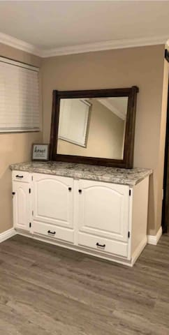 The vanity outside the bathroom to do your makeup & hair.