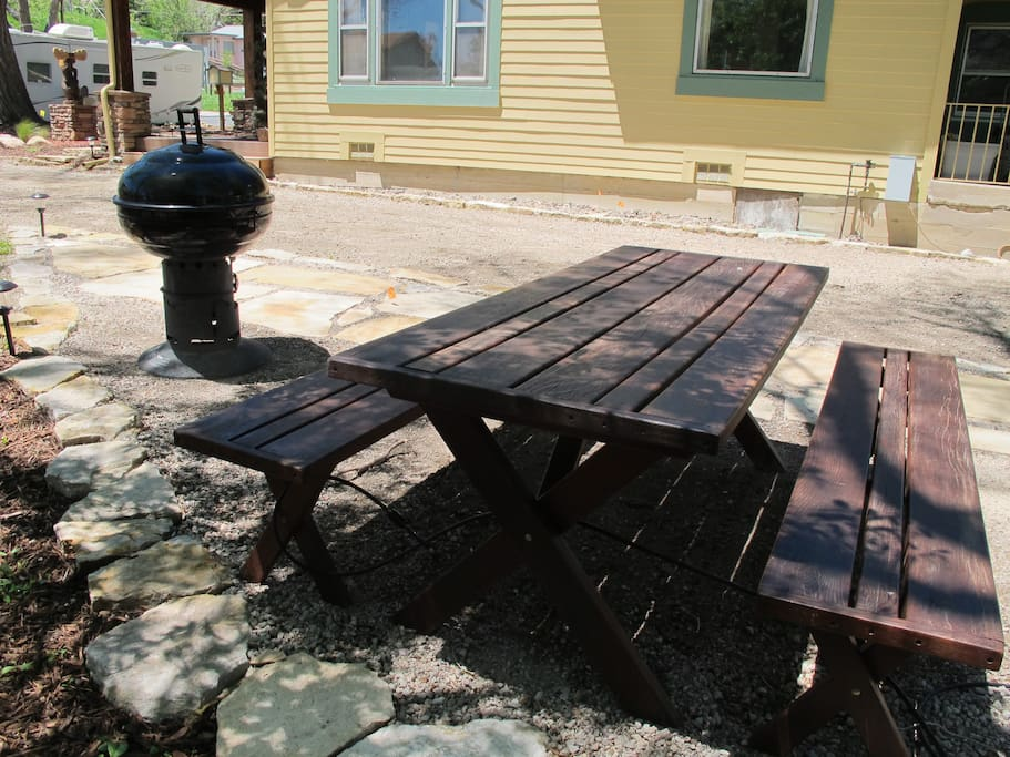 Picnic table and grill available for use.