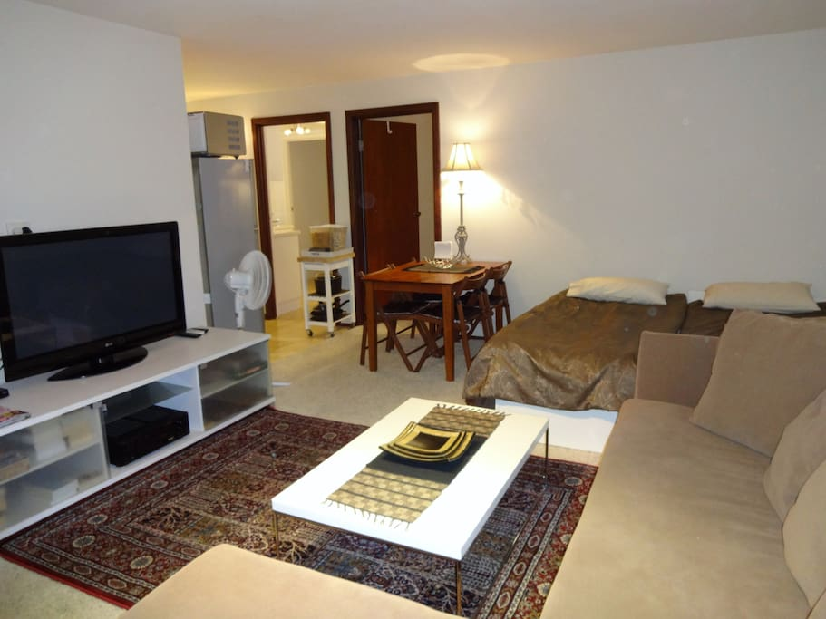 Super comfortable lounge and living area. The one bedroom has a queensize bed, two singles in lounge area