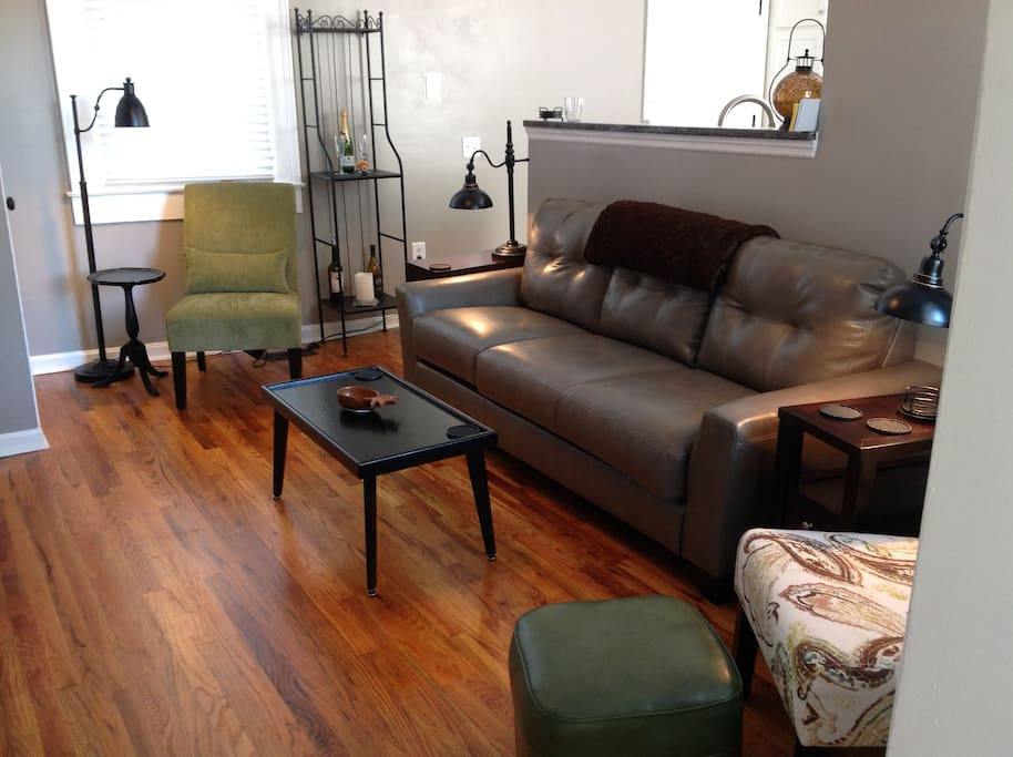 New couch and chairs with refinished hardwood floors