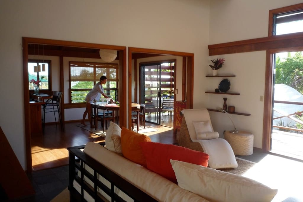 Gracious Island living ~ This view is from the entry across living room to dining and lanai.
