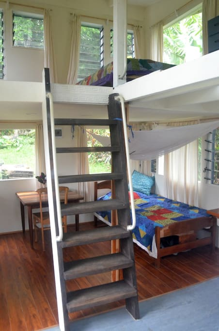 Steep ship's style stair takes you to upper room where there is double bed.
