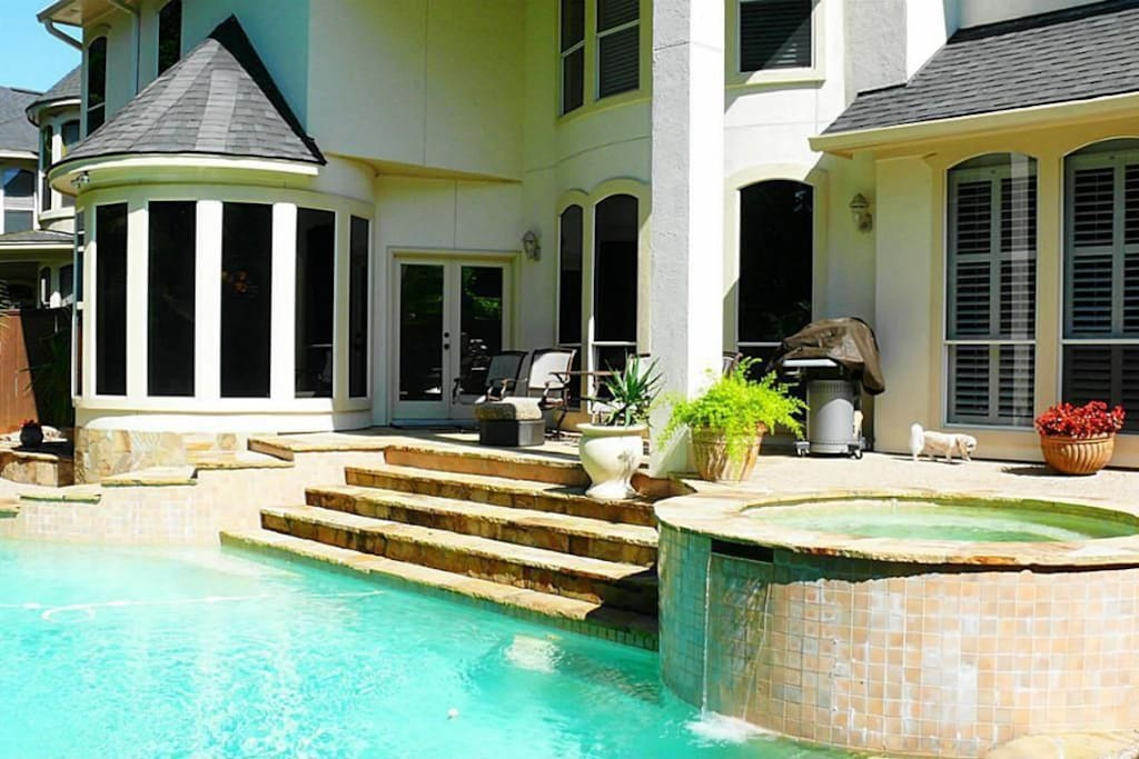 Resort style heated salt water pool and hot tub area