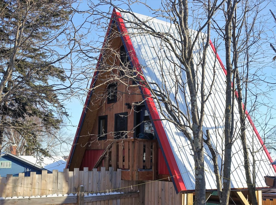 The Birdhouse, built up in the trees, gives you a bird's eye view of the Grand Marais harbor