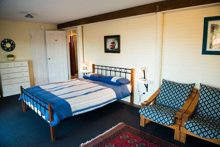 Downstairs bedsit with queen bed and ensuite