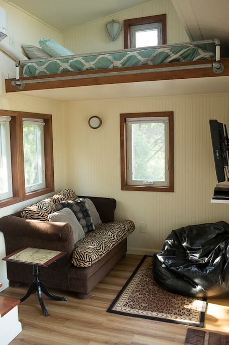 Living room of a Tiny House.  Single sofa bed.