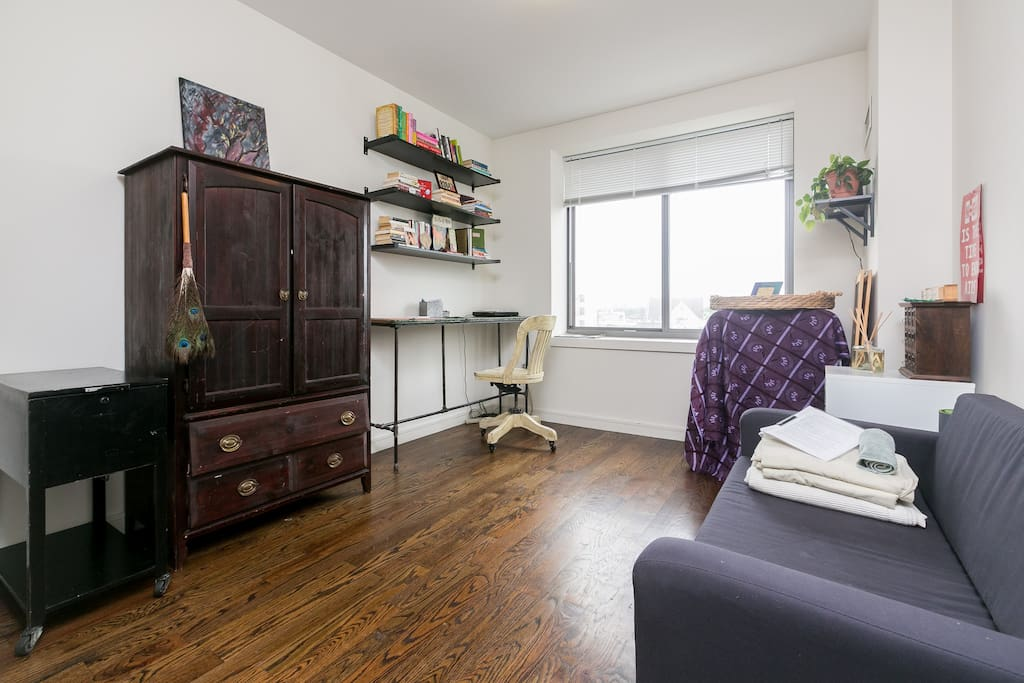 The view of your room when you walk in- except it's recently upgraded! We replaced the couch you see here with a Queen-sized futon that is much more comfortable, a full dresser with multiple drawers for storing your clothes, and a comfy chair for lounging.