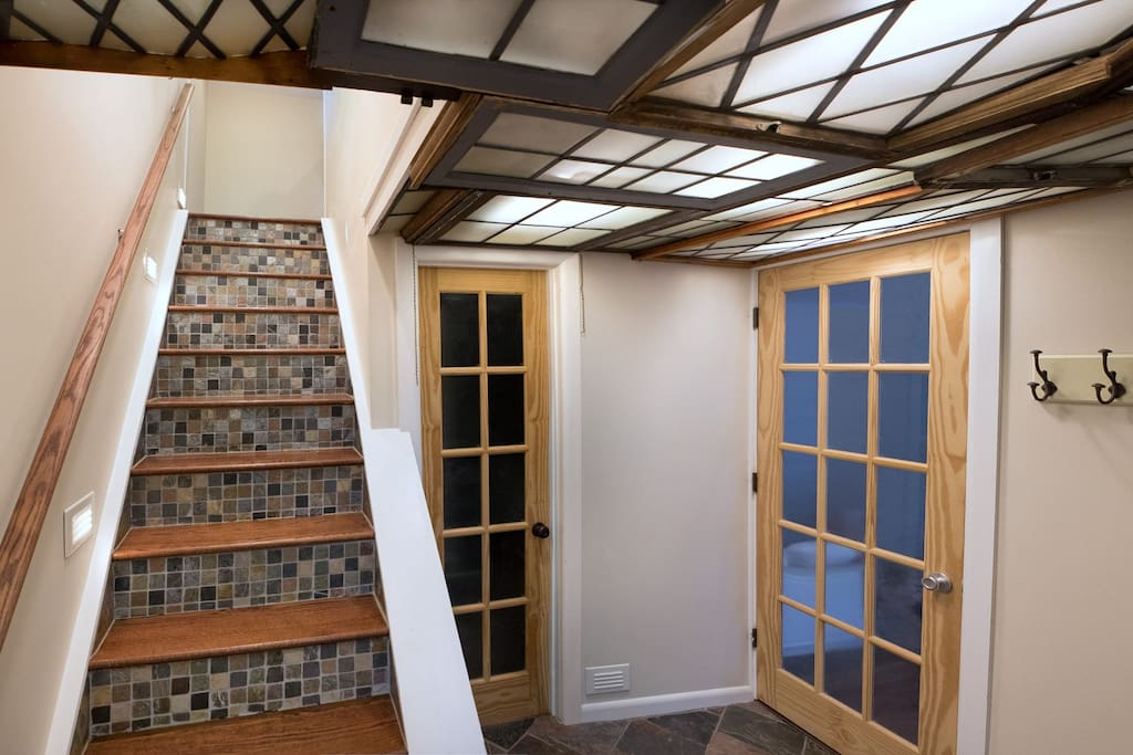 Entry way adorned with handpicked reclaimed window panes.