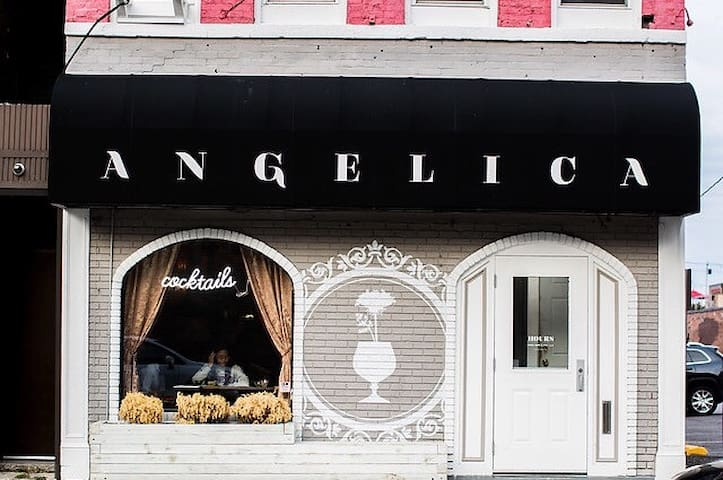 Angelica Tea Room (You will enter the building through the bar entrance door on the right).
