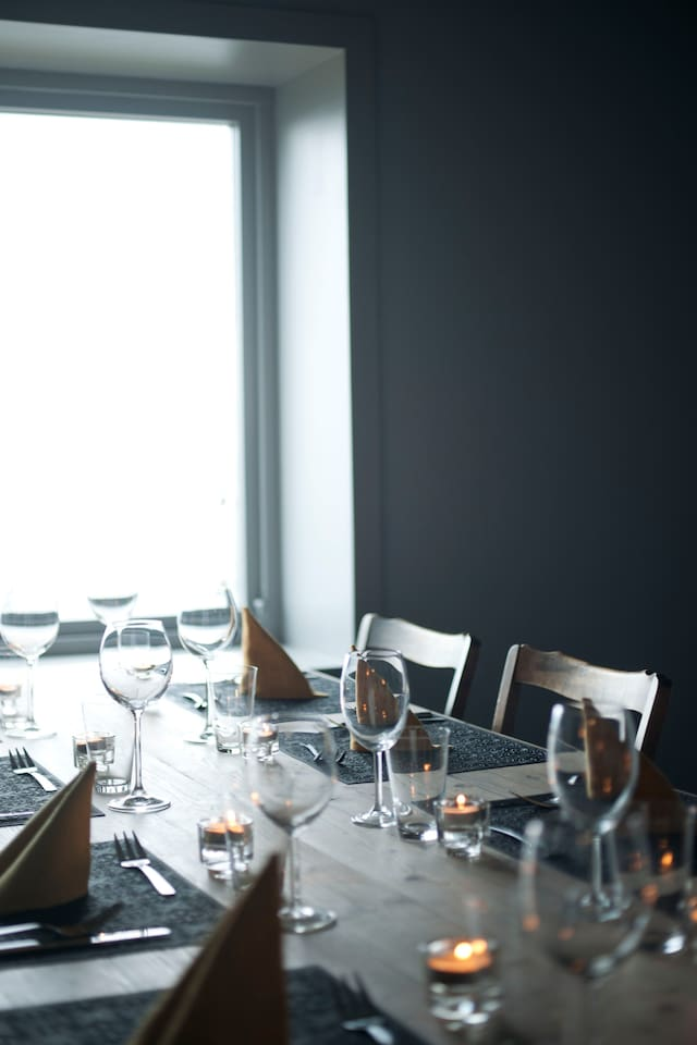 The long table in the dining room has space for eight persons.
