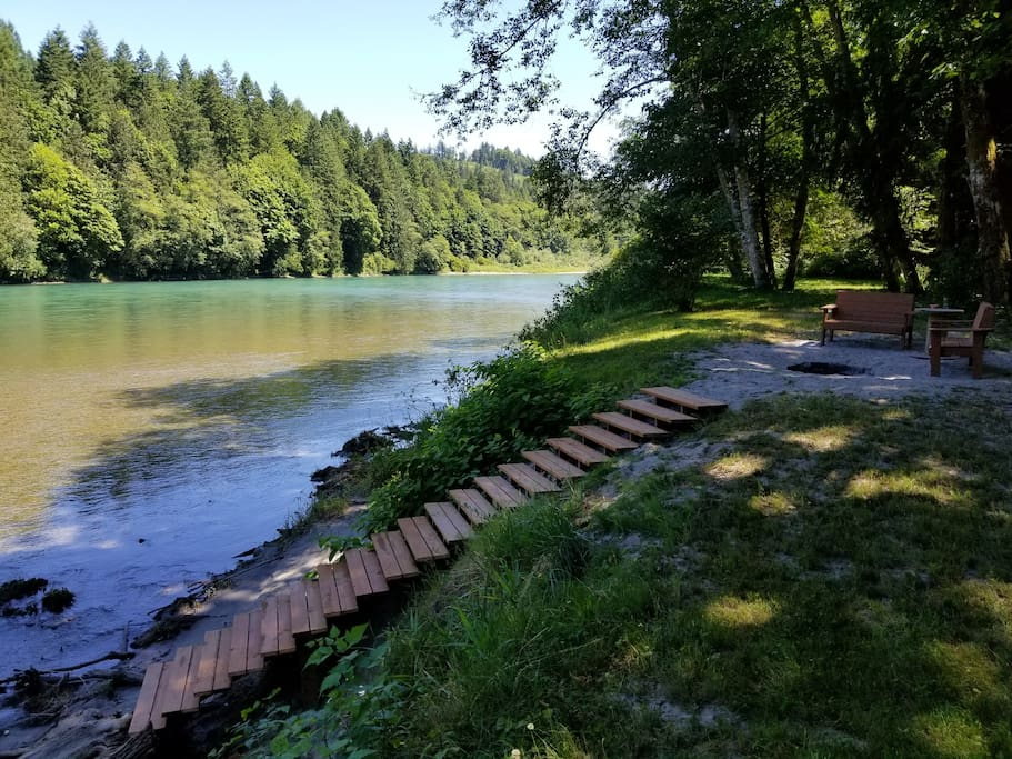Benches by the fire and views of state land across the Skagit River.
