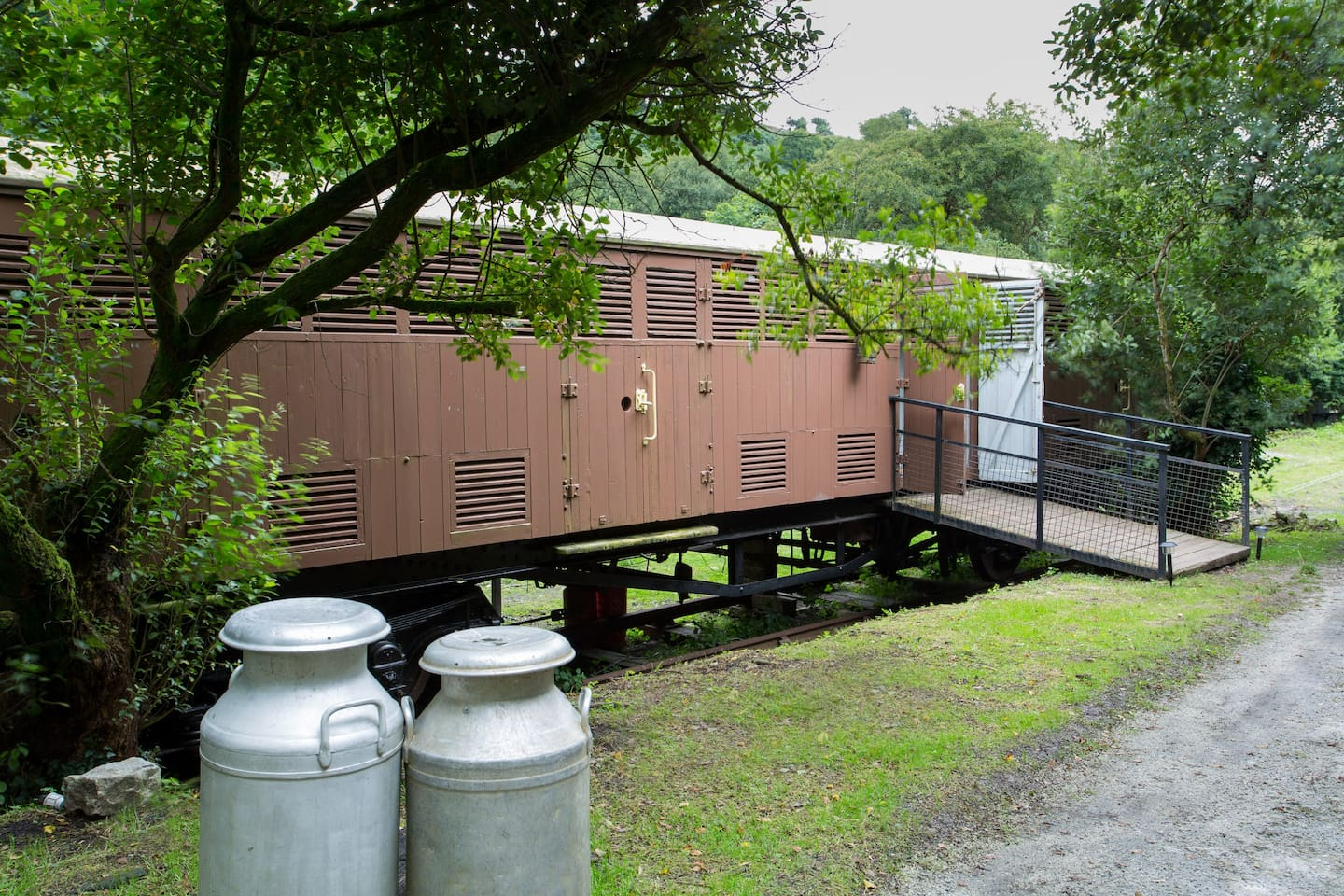 The Siphon railway carriage was used to carry milk churns (just like these!) from the West Country to the Cities of the UK. The carriage now offers an exciting glamping experience