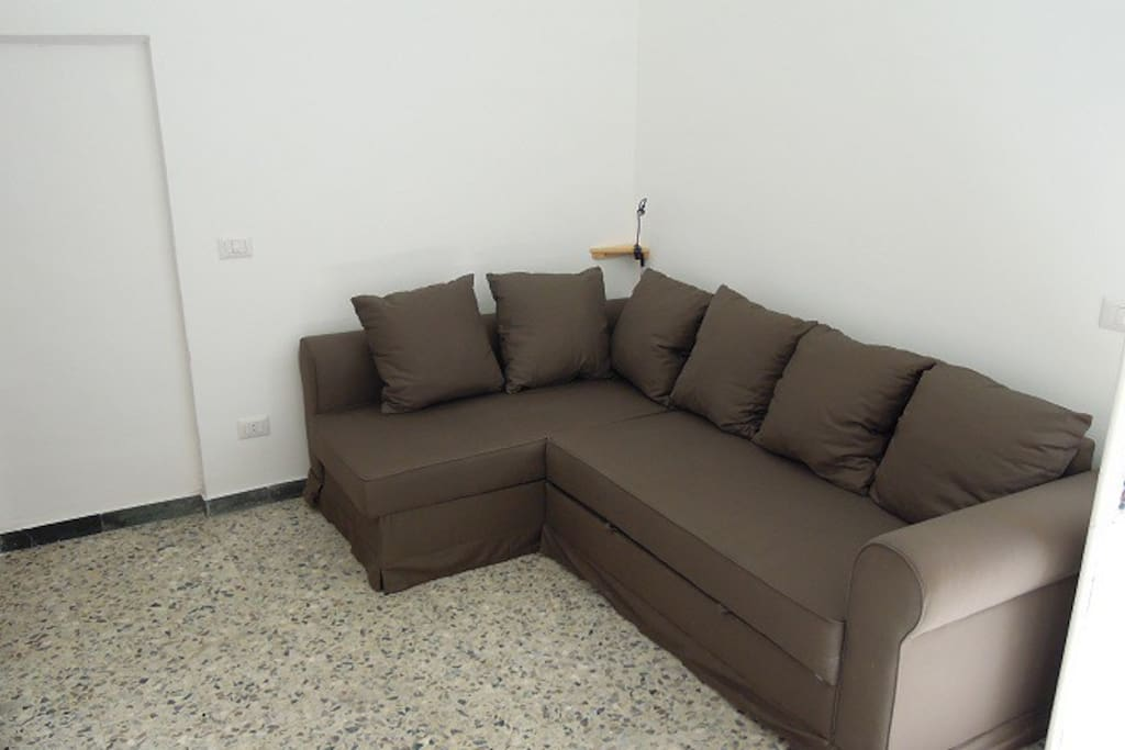 The sofa bed as it may appear during the day