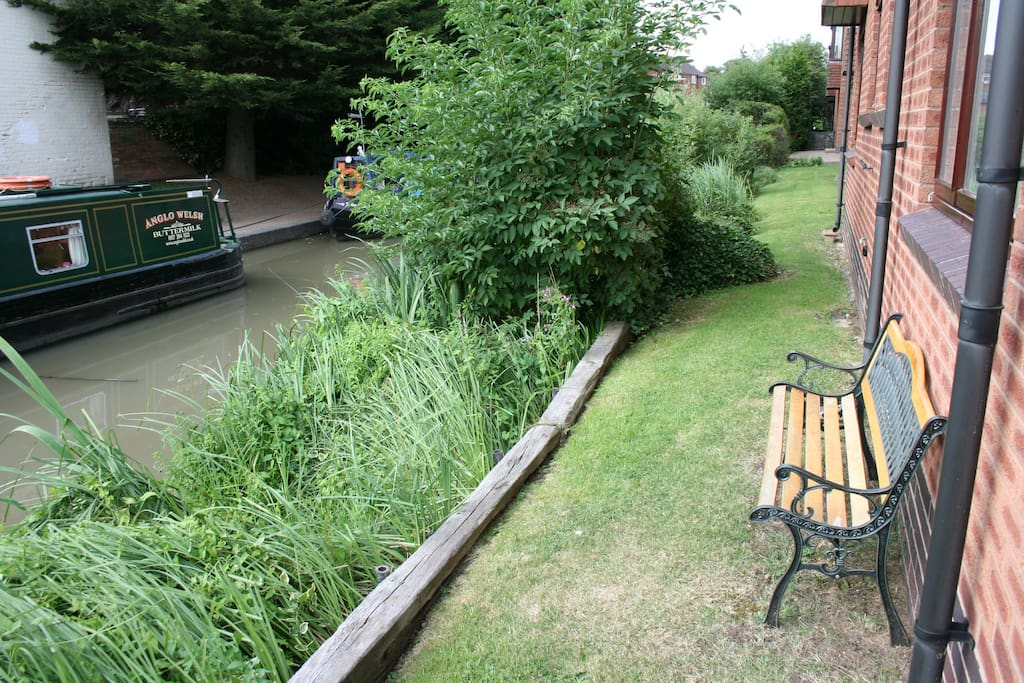 Our Garden Bench outside rear of apartment to enjoy a drink and watch the barges and wildlife passing by!