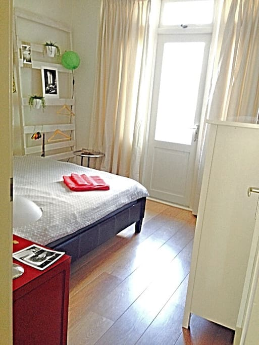 Large bedroom with entrance to balcony