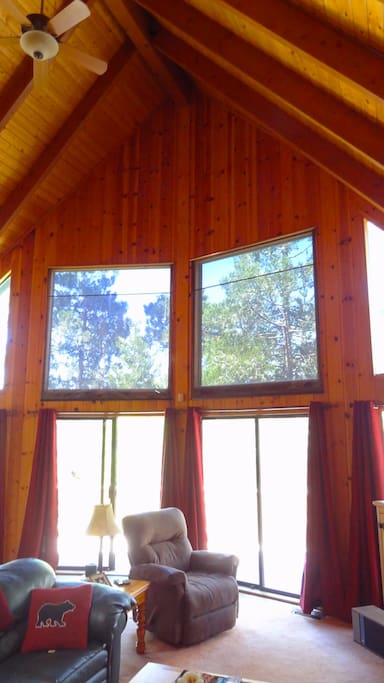 The vaulted ceiling and windows fill the room with light