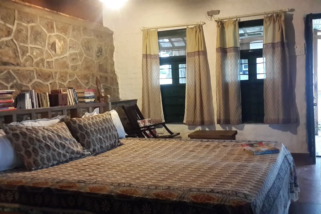 Valley view bedroom with charming cosy rustic interiors with a spacious verandah and en suite bathroom