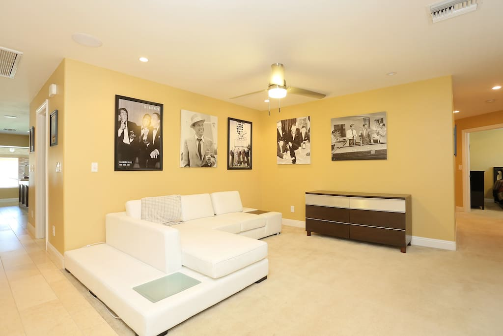 Main entrance with  a handful of the 40 + 3 foot Sinatra Rat Pack Canvas Paintings throughout the home.