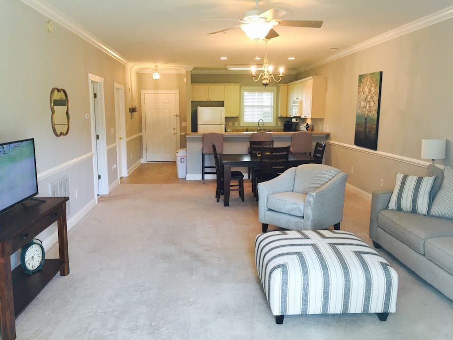 Beautiful great room with all new furnishings over looking the golf course