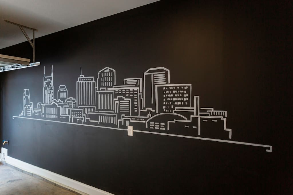 If you enter through the garage, you'll be greeted by our custom hand painted Nashville Skyline Mural in garage. Great back drop for selfies and group photos!