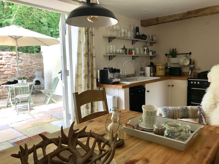 The cottage kitchen is fully equipped with a Nespresso coffee machine, dish washer, washer/dryer, microwave, electric cooker, and a fridge/freezer.