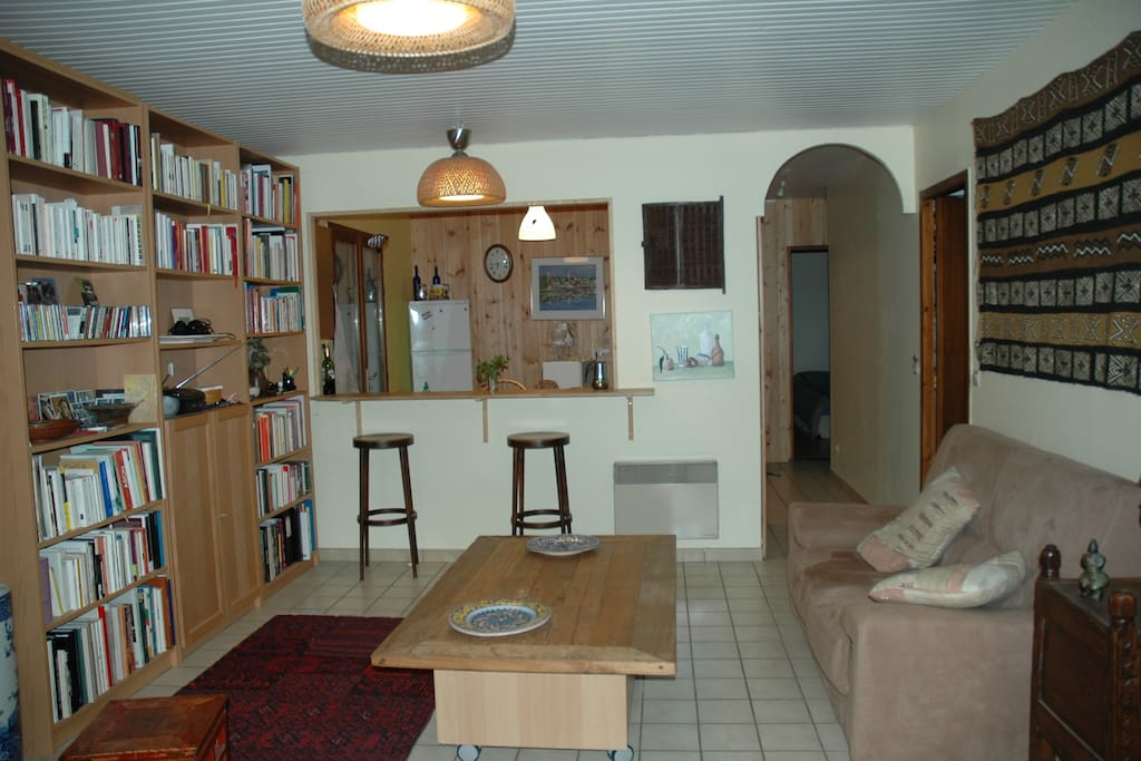 living room, opening of the kitchen (to the right, door to the dining room, end of hall way, main bedroom