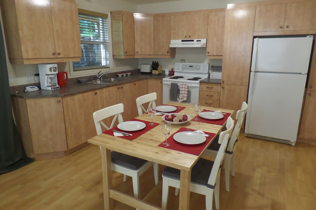 Cook in a fully stocked kitchen with table that seats up to 6 so you can invite guests for dinner (the extension is next to the fridge and the extra folding chairs are in the hall closet).
