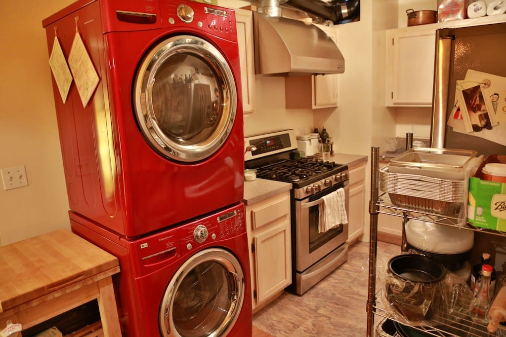 Washer dryer limited use but available. View of stove and powerful hood range.