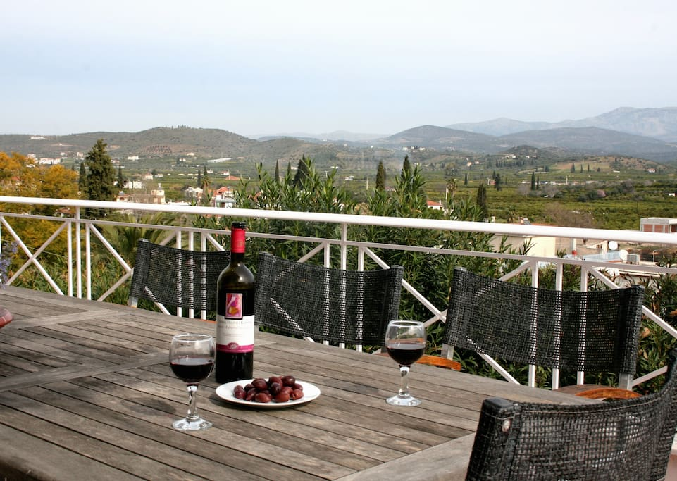 A Bottle of Red, a few Kalamata Olives and a Perfect Peloponnese View to watch at the End of the Day