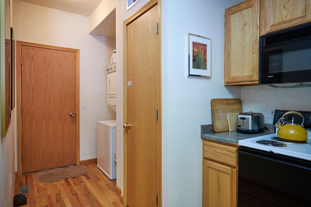 Hallway from private garage with washer/dryer