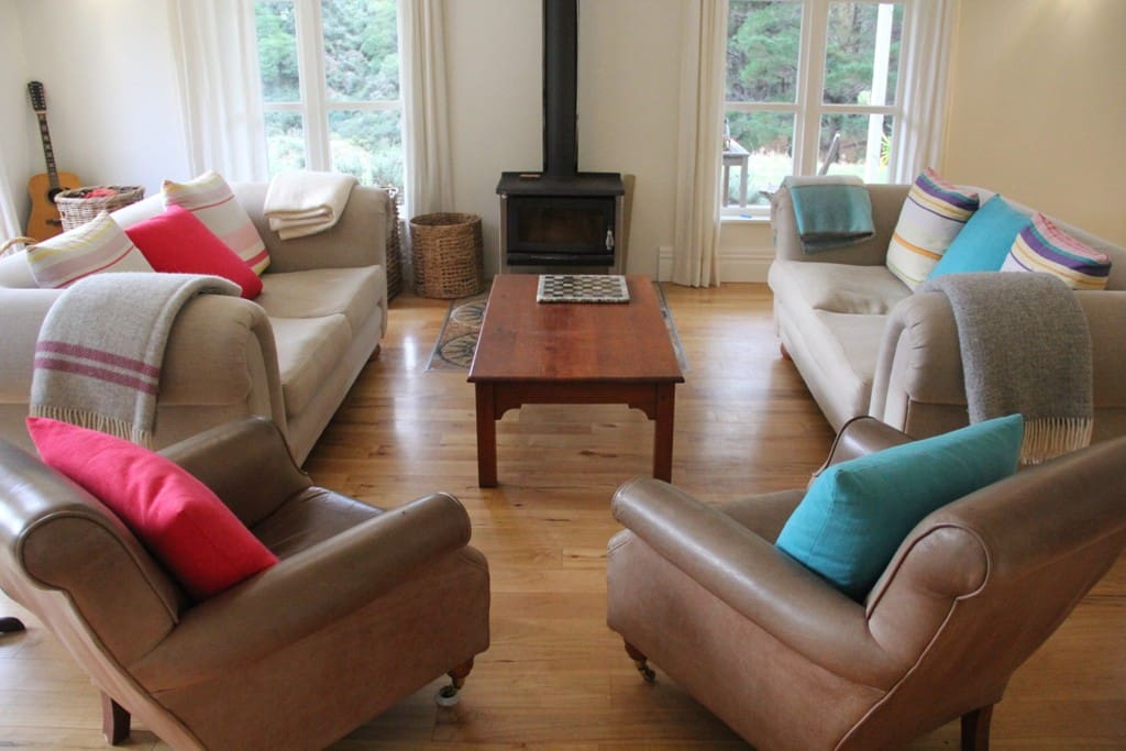 Sofa's and chairs by the wood burner
