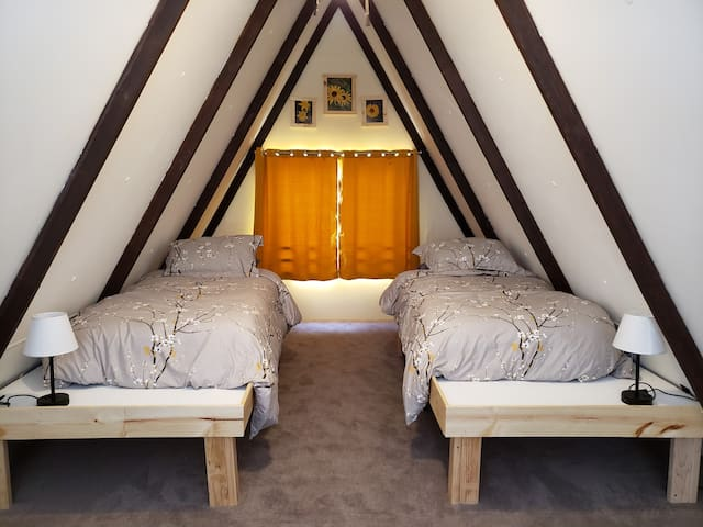 Loft bedroom. Two twin beds. Brand new mattresses. Lamps have USB ports for easy charging of devices.