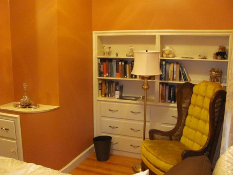 A niche with reading chair floor lamp and built-in bookcase !
