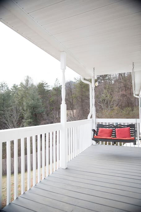 You're greeting by amazing views and quaint features like this adorable two person porch swing.
