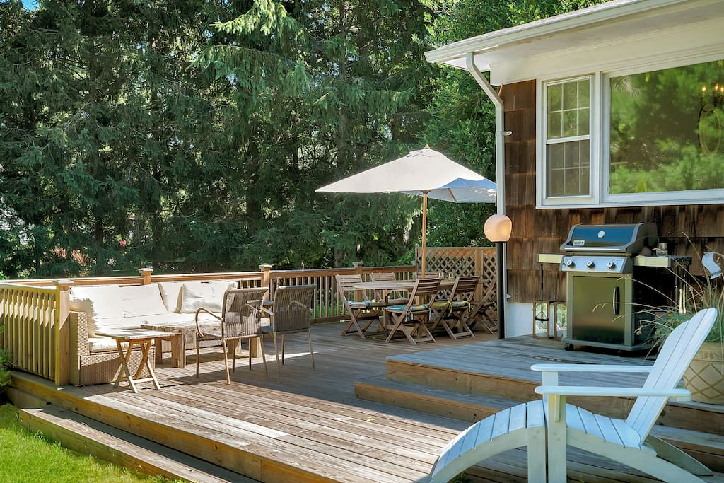 A lovely deck with dinning and lounge area and weber BBQ