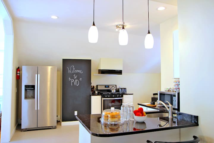 The eat-in kitchen is newly renovated and includes brand new stainless steel appliances as well as all of the essentials for cooking and baking!