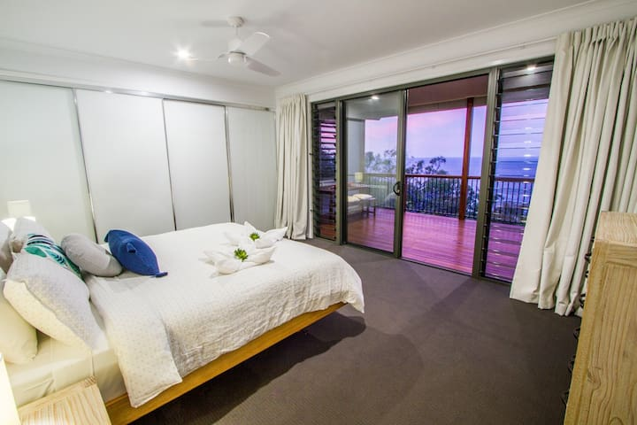 King master bedroom with ocean views, deck access and generous ensuite