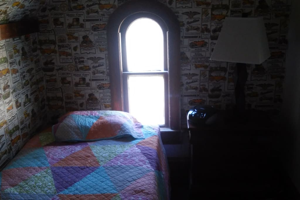 small window and reading lamp
