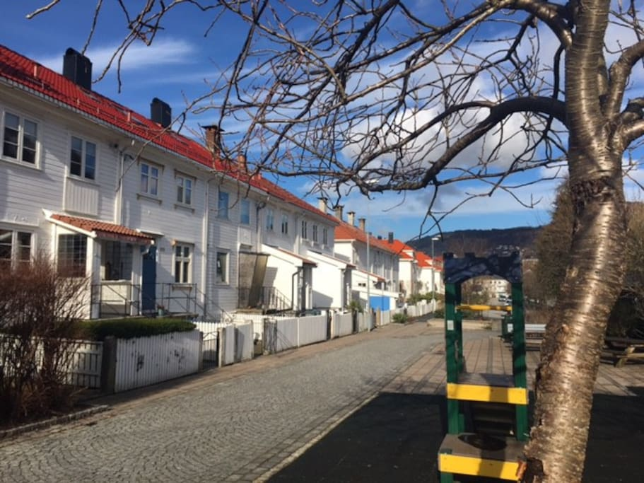 Welcome to St Olavs  street. Its an urban, but quiet nabourhood, with all white, traditional houses. Its a playground right outside the house.