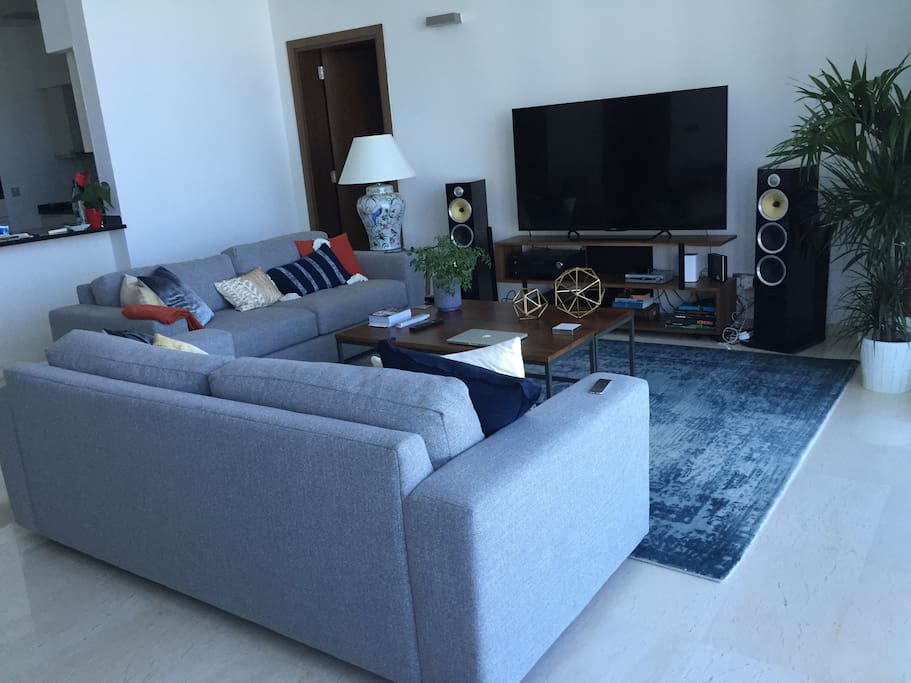 Comfortable and elegant living area with 70inch TV and sound system