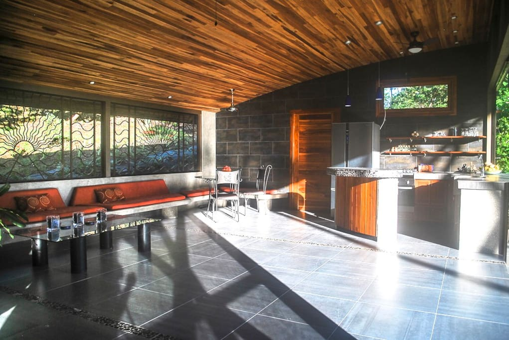 Ken was inspired by John Lautner architect. He's aim was to bring in minimize the distinction between indoors and out.