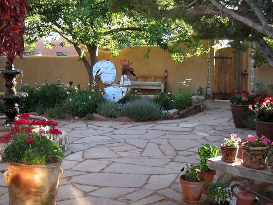 Mexican fountain, sculpture and flowers..view from private seating area outside guest bedroom.
