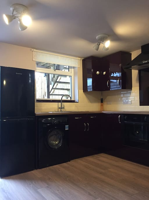Fitted kitchen with washing machine and fridge freezer